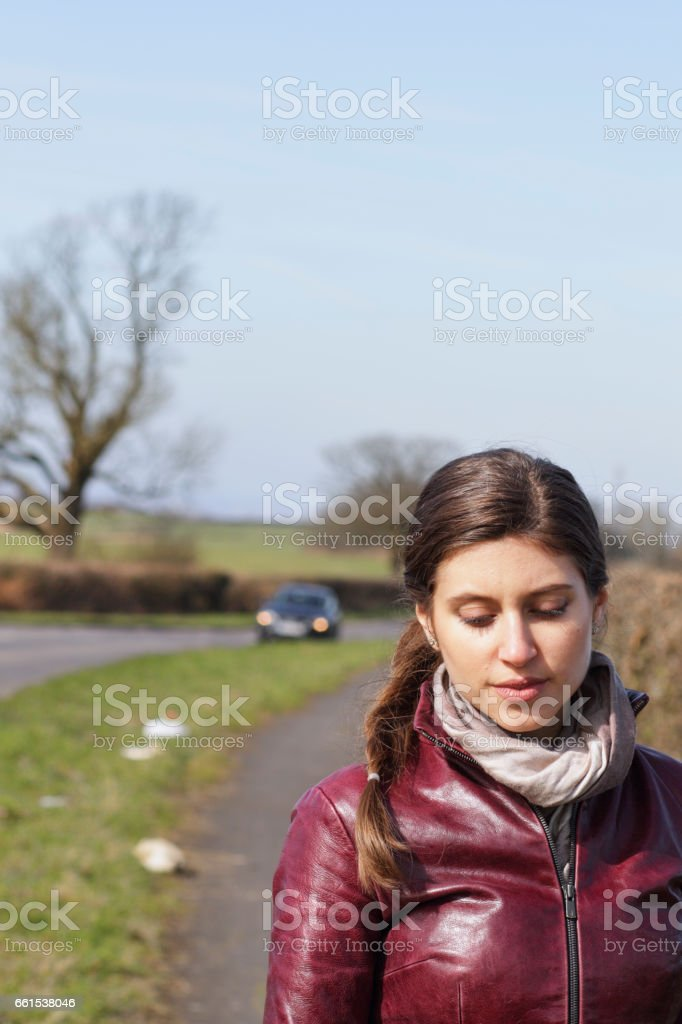Moody beautiful Russian outdoor girl at roadside stock photo