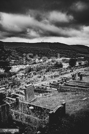 25th July, 2020 - Moody black & White image of the graveyard of Aberfan looking down on the beautiful Welsh valley below. Sadly best known as the final resting place of the 116 children and 28 adults who tragically died on October 21st, 1966 as a result of a when a colliery spoil tip collapsed onto homes and the school below