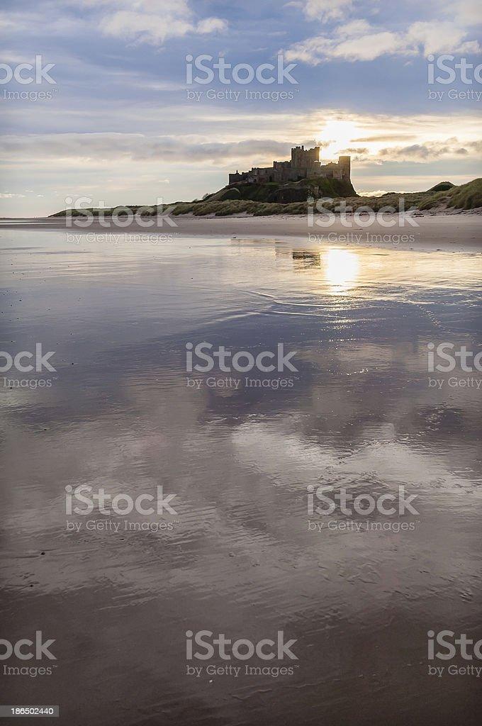 Moody blue sunrise Bamburgh Castle Northumberland stock photo