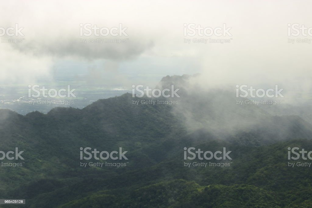Moody fog over mountain scenery in rainy day. royalty-free stock photo