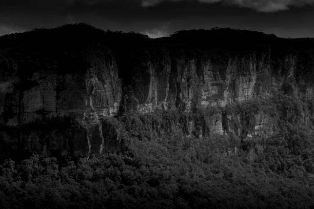 Moody looking cliff face in the Blue Mountains, NSW, Australia stock photo