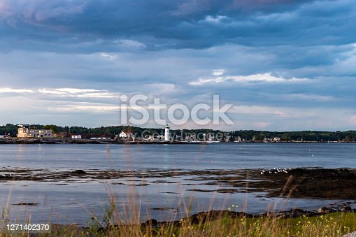 Moody ocean scene with lighthouse in the distance. in New Castle, NH, United States