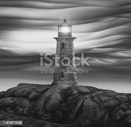 Peggy's Cove Lighthouse with composite lens flare and clouds.
