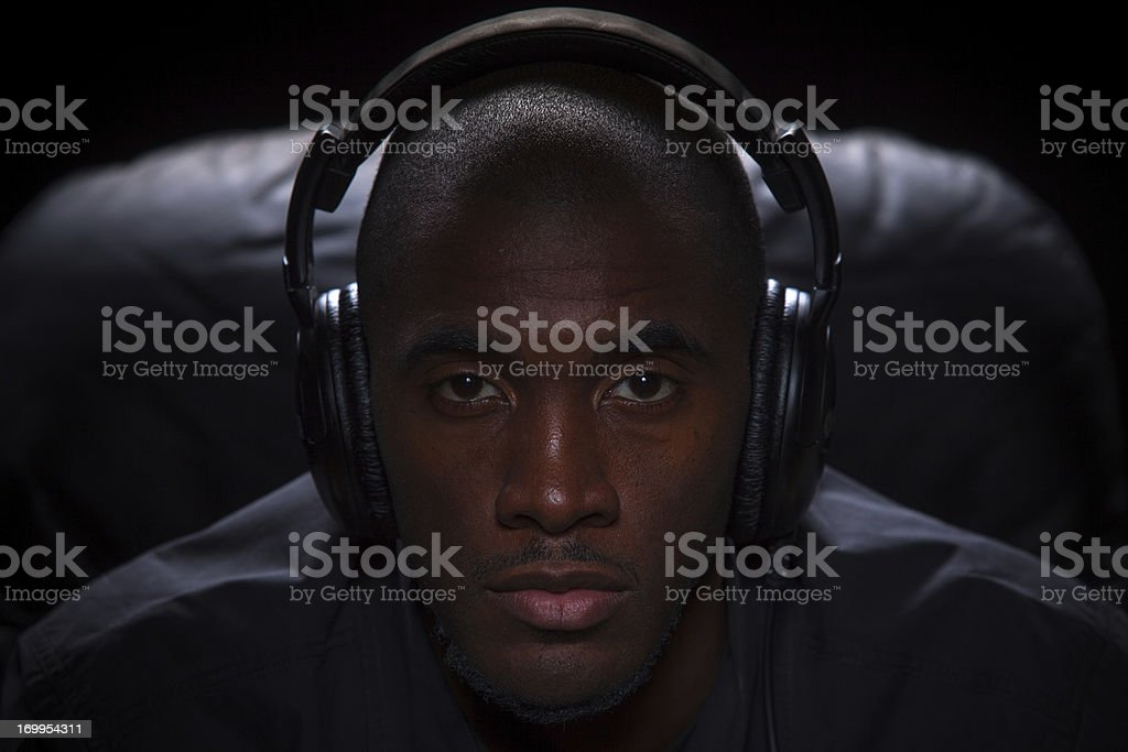 Moody Portrait of Man Listening to Music royalty-free stock photo