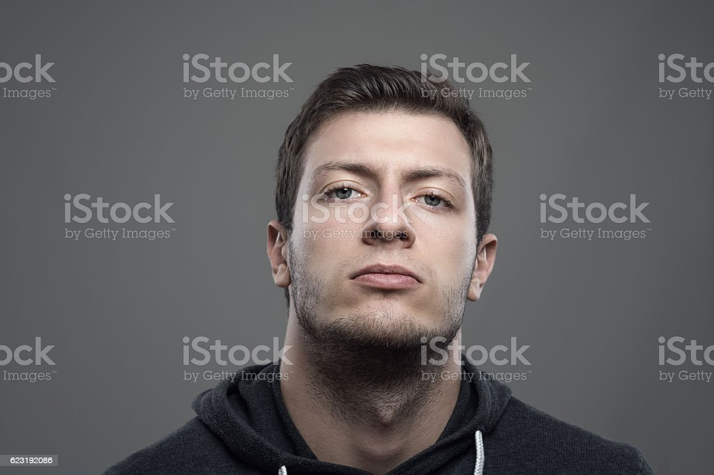 Moody portrait of proud young man with head leaned back stock photo