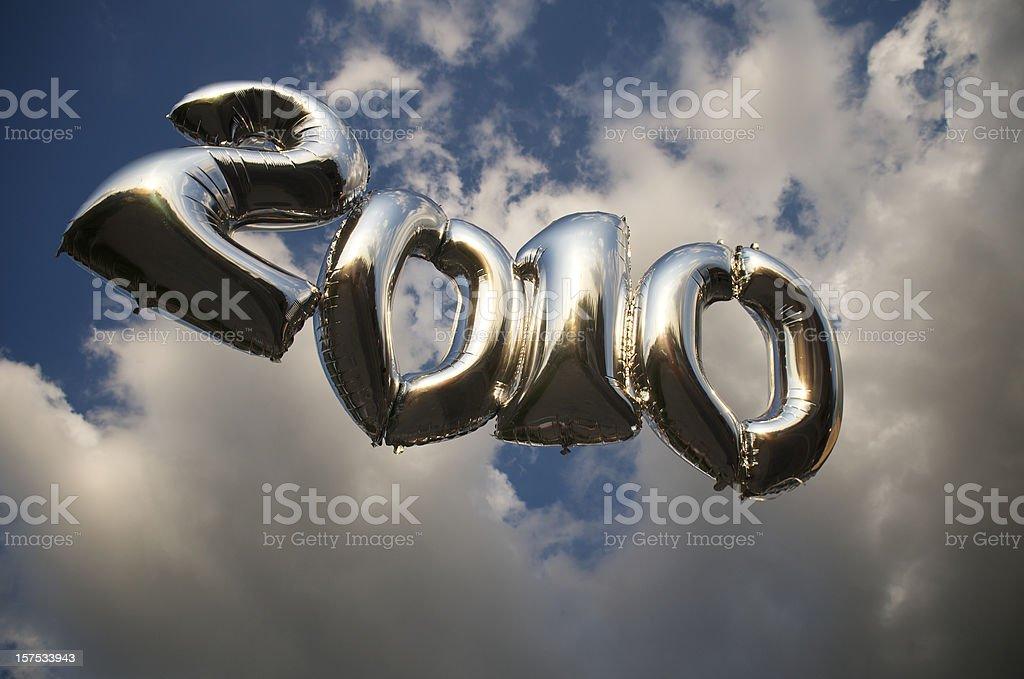 Moody Silver 2010 Balloons Float in Dusky Sky stock photo