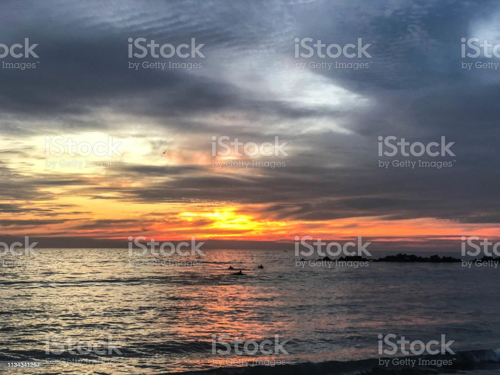 Moody skies at sunset over the Pacific Ocean horizon in Venice, CA