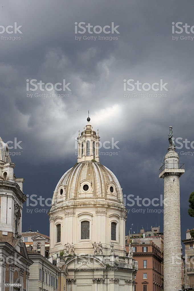Moody sky and beam of divine light over a church royalty-free stock photo