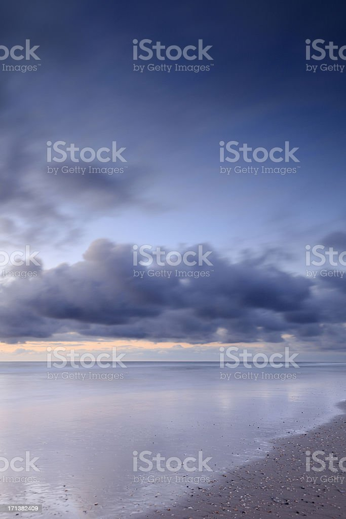 moody sky and its reflection in the water royalty-free stock photo