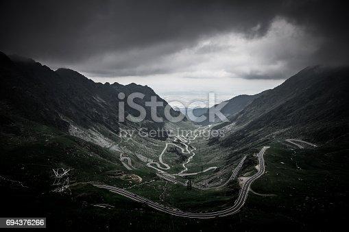 istock Moody sky and mountain landscape at Transfagarasan road, Transylvania, Romania 694376266