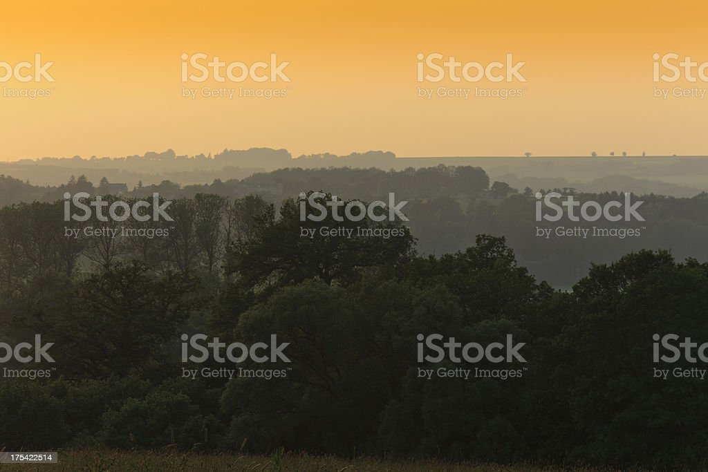 moody sky in the Belgian Ardennes stock photo