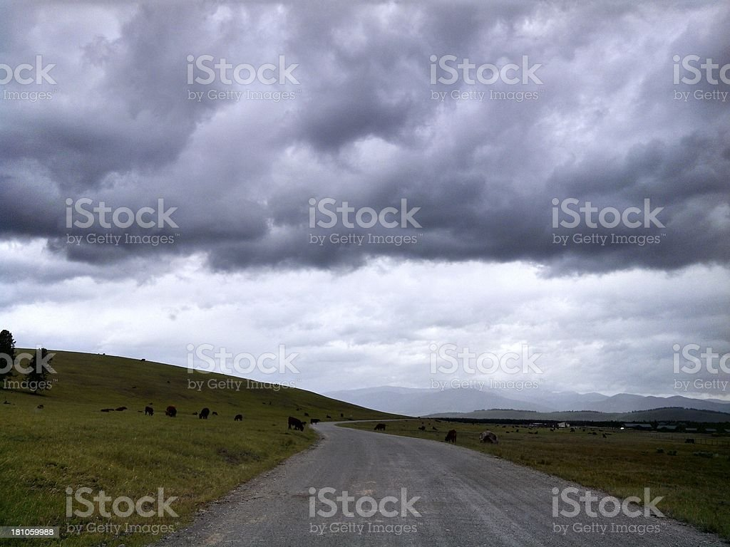 Moody Sky over Country Montana Road royalty-free stock photo