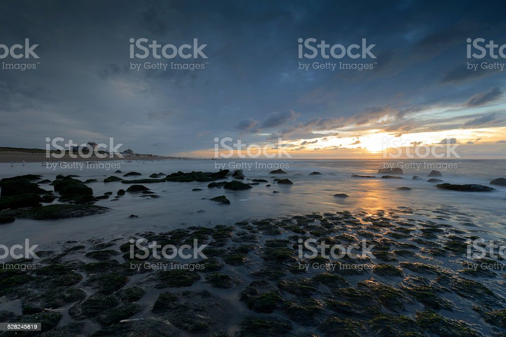 moody sky over Kijkduin, one of the seaside resorts of The Hague: The...