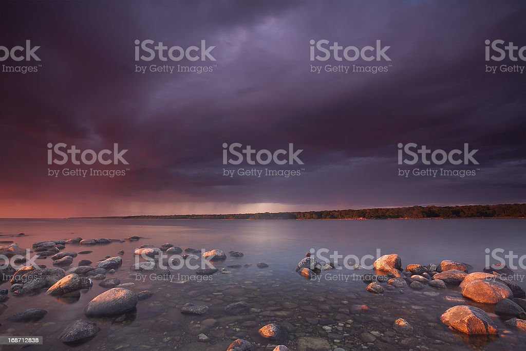 Moody sky over ocean, thunderstorm and rain approaching royalty-free stock photo