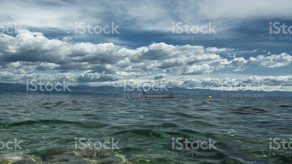 Moody Sky Sea Boat and Coast stock photo