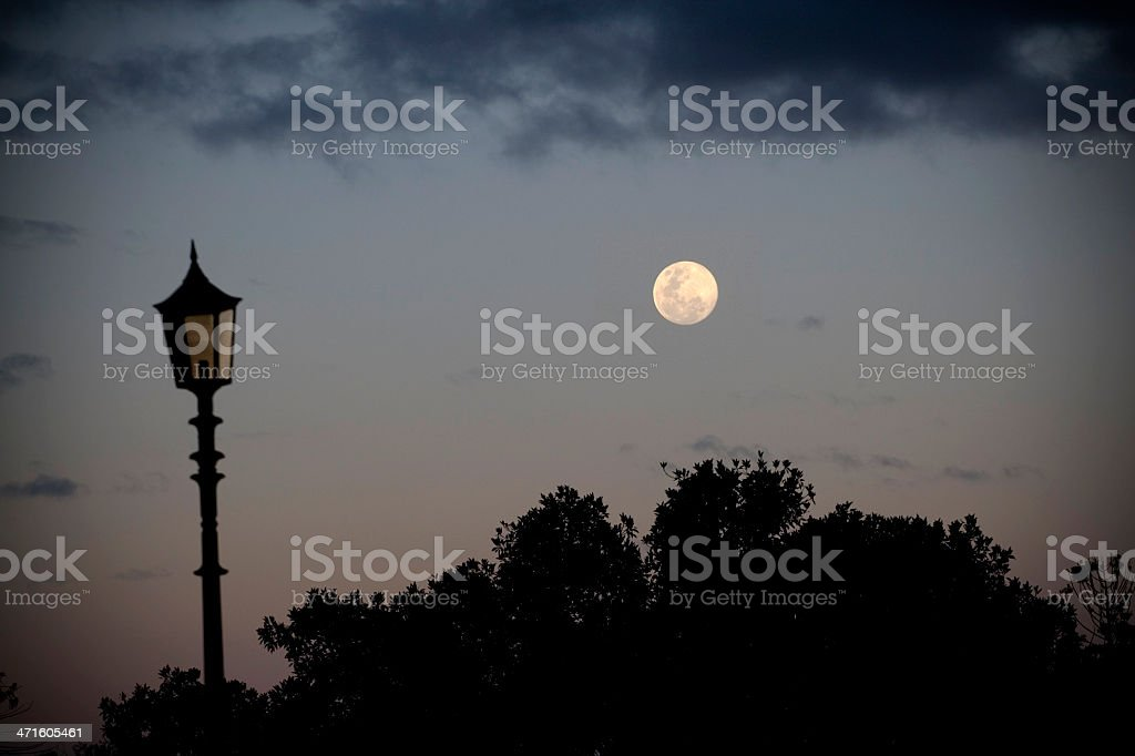 Moon and antique-style lamp royalty-free stock photo