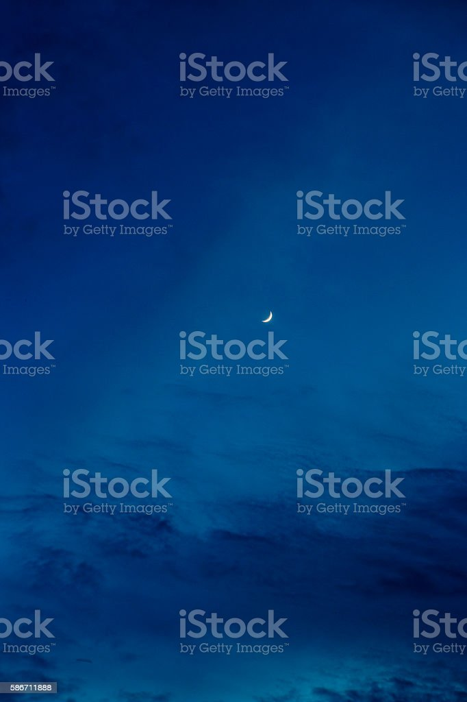 Moon and blue sky in the night stock photo