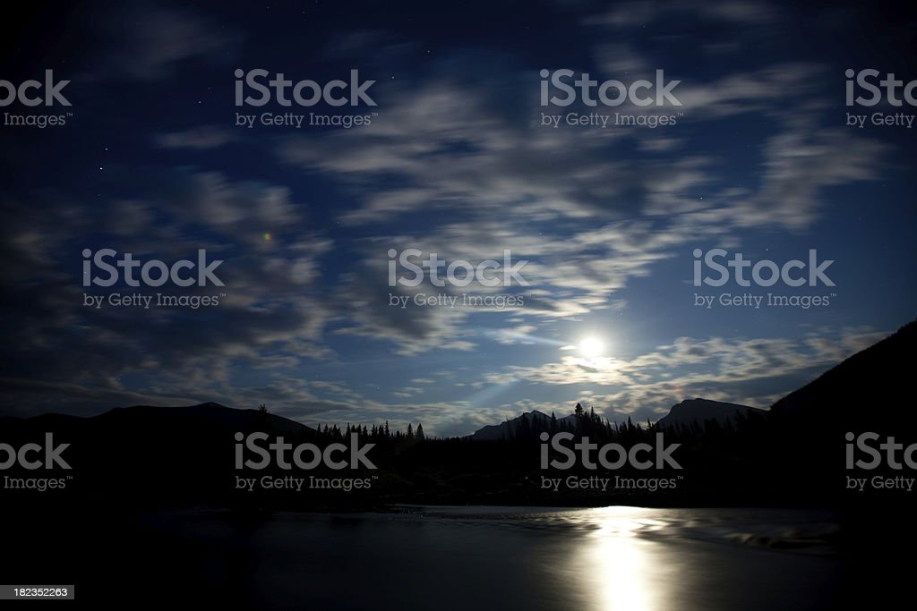 Moon and Clouds over a River royalty-free stock photo