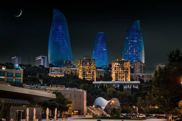 Moon and Flame Towers skyscraper at night in Baku,  Azerbaijan. stock photo