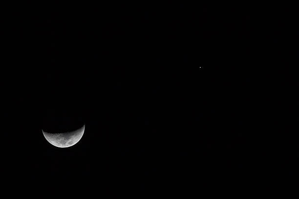 Moon And Jupiter Conjunction Stock Photo & More Pictures of