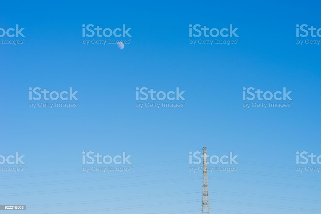 Moon and steel tower stock photo