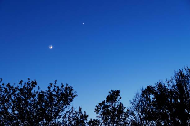 Moon and Venus at dusk stock photo
