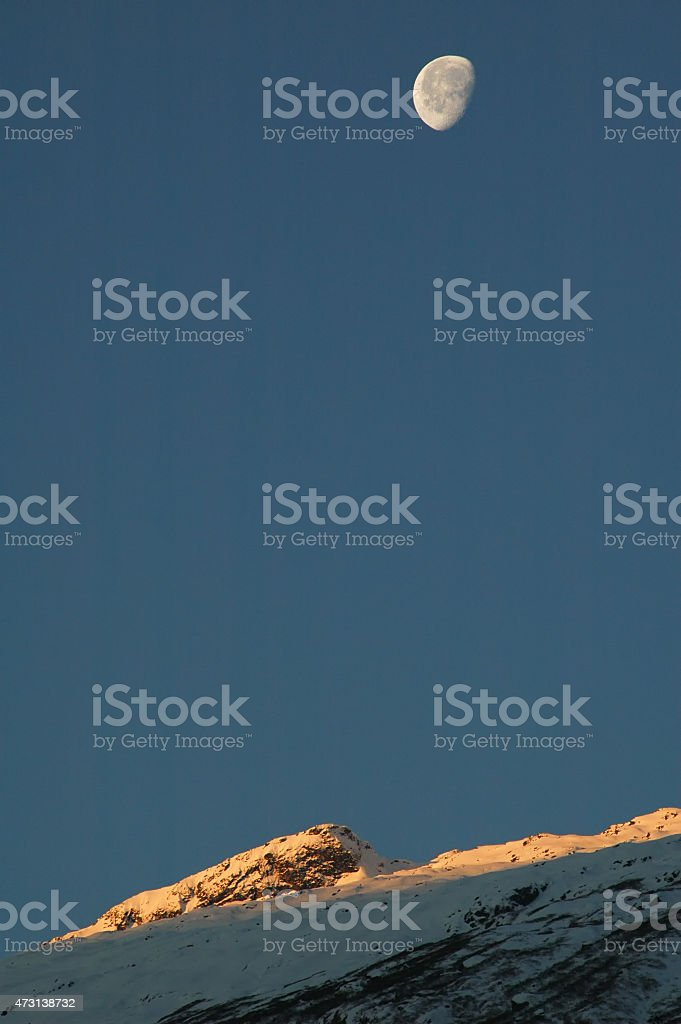 Moon at sunset. Sikkim. Eastern Himalaya. stock photo
