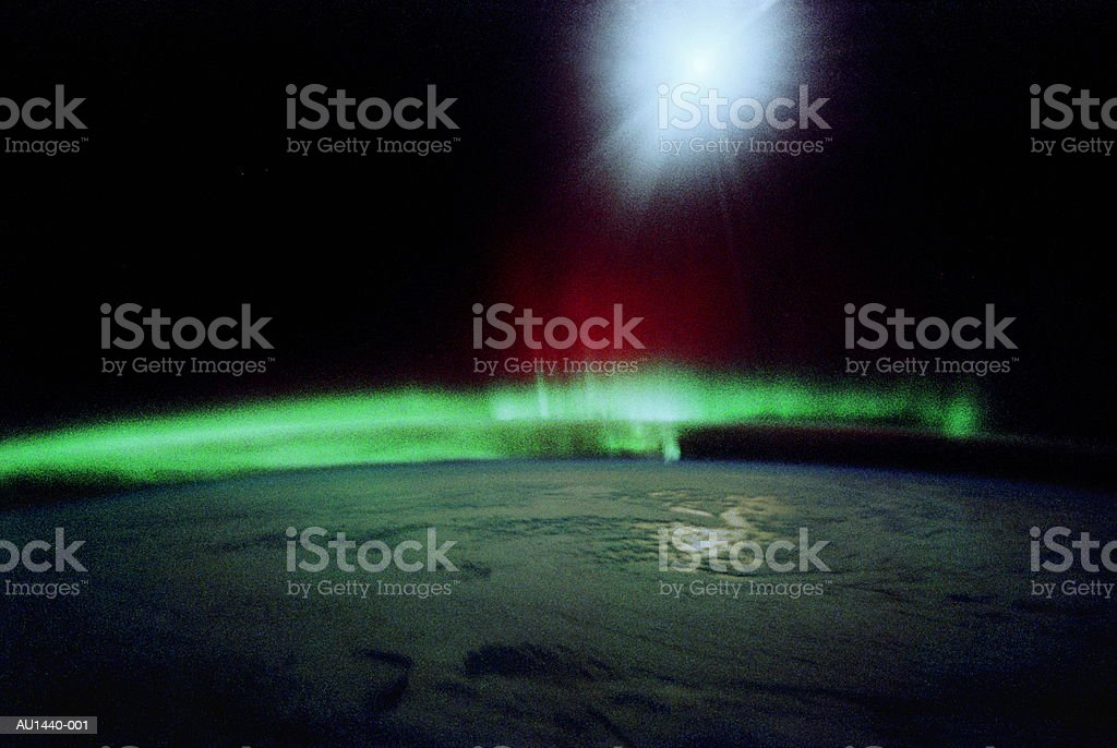 Moon, aurora, clouds over Indian Ocean, satellite view (Enhancement) royalty-free stock photo