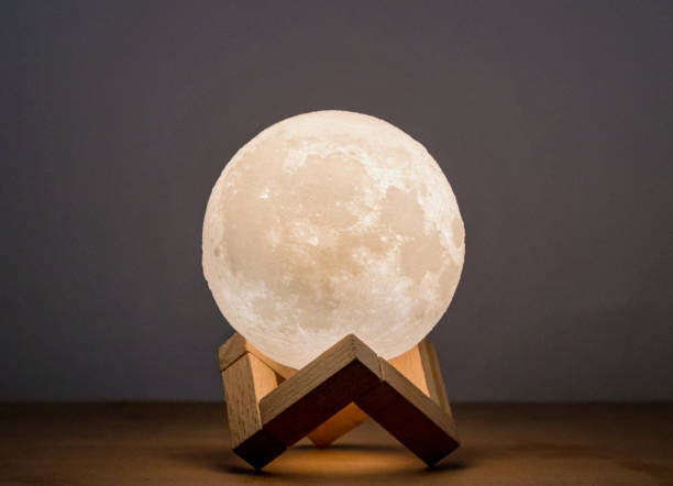 Moon bedside lamp in a wooden stand stock photo