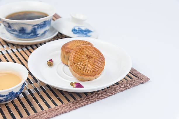 Moon cake and tea on the wooden background stock photo