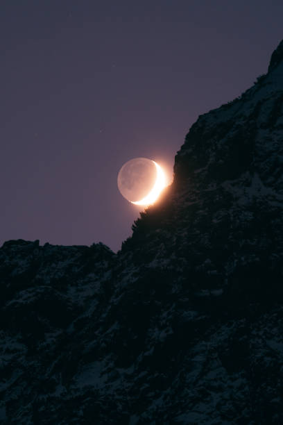 Moon eclipse in the mountains stock photo