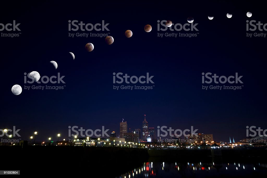 Moon eclipse over city stock photo