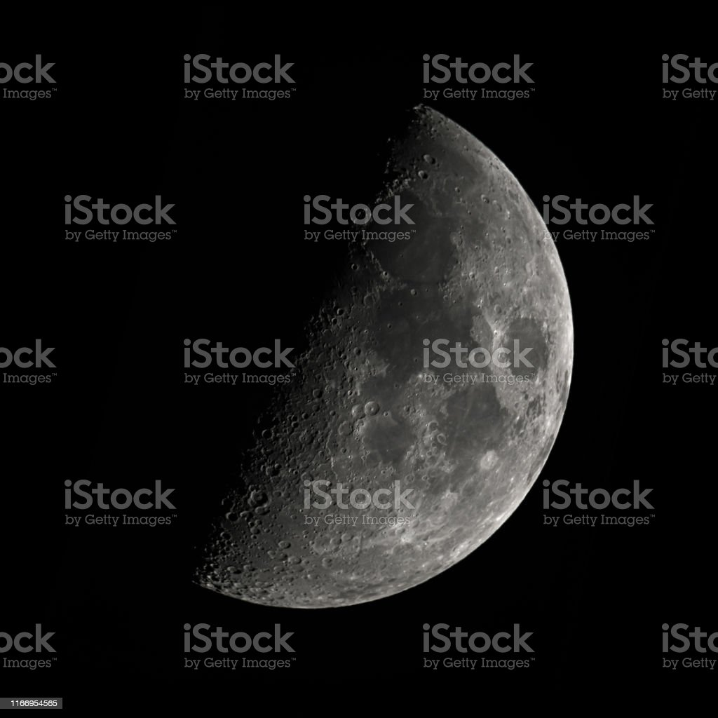 moon first quarter phase, fifty percent lighted by the the sun, view...