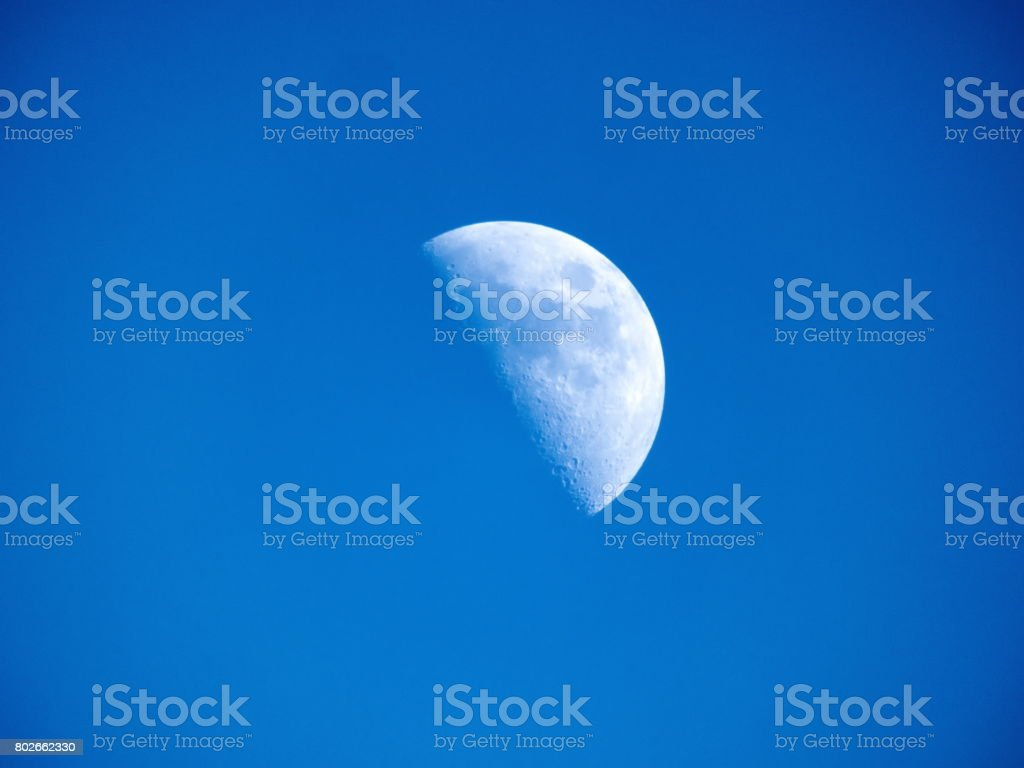 Moon First Quarter Third Quarter - Day stock photo
