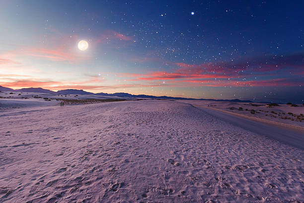 moon gazers - twilight stock photos and pictures
