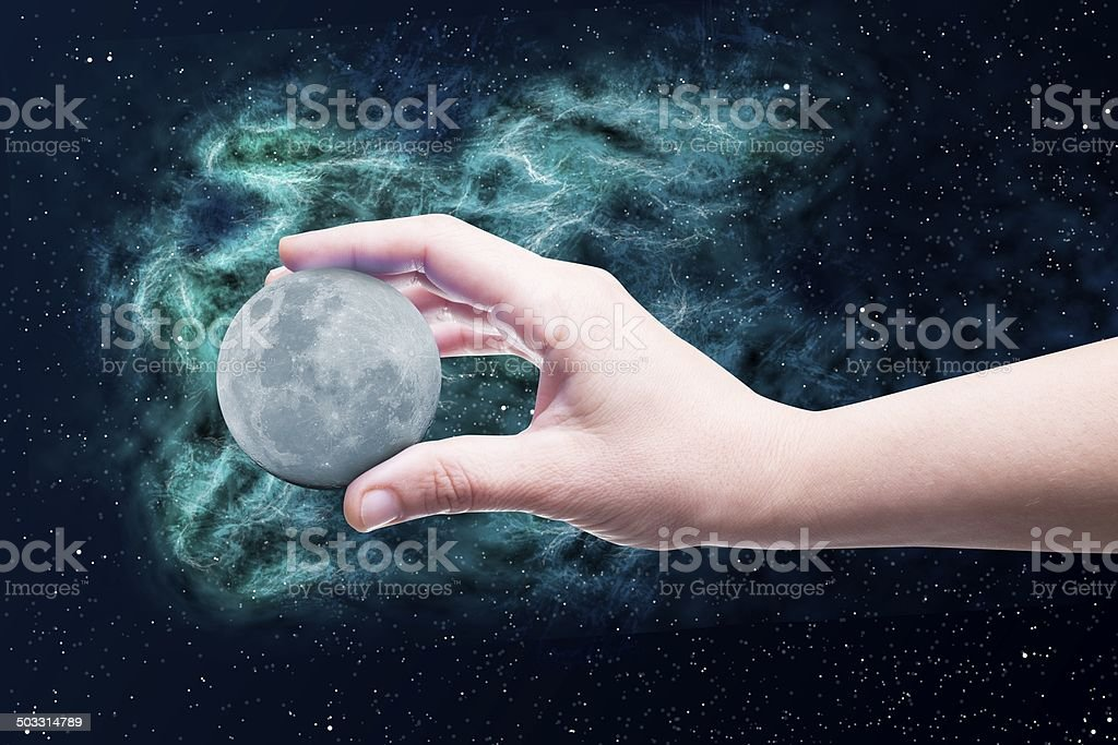 Moon in a hand stock photo