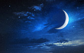 moon in blue cloudy sky