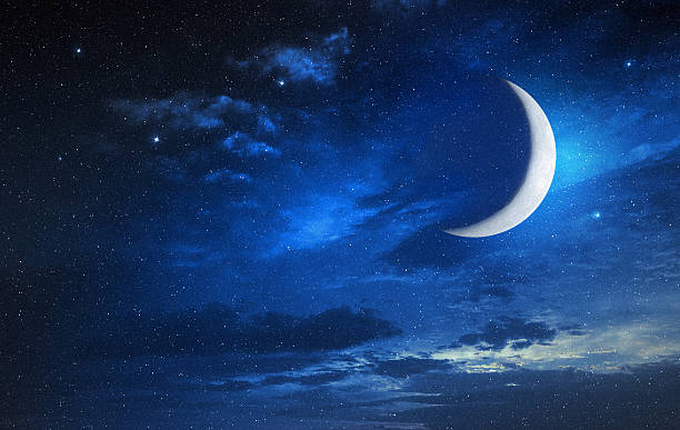 moon in blue cloudy sky stock photo
