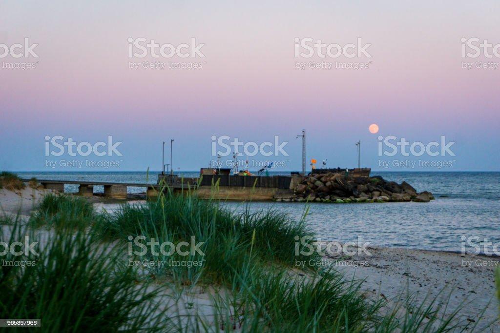 Moon is rising over idyllic Bornholm, Denmark on a day in summer zbiór zdjęć royalty-free