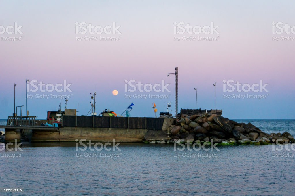 Moon is rising over idyllic Bornholm, Denmark on a day in summer zbiór zdjęć royalty-free