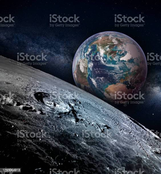 Photo of Moon landscape with earth rise on a starry sky, elements of this image furnished by NASA.