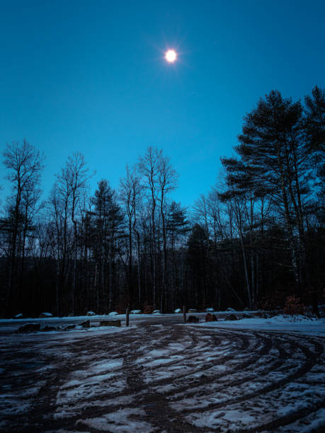 Moon Light on a winter parking lot stock photo