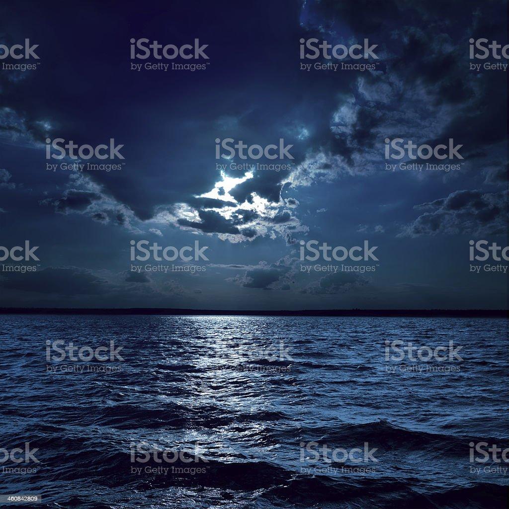 moon light over darken water stock photo