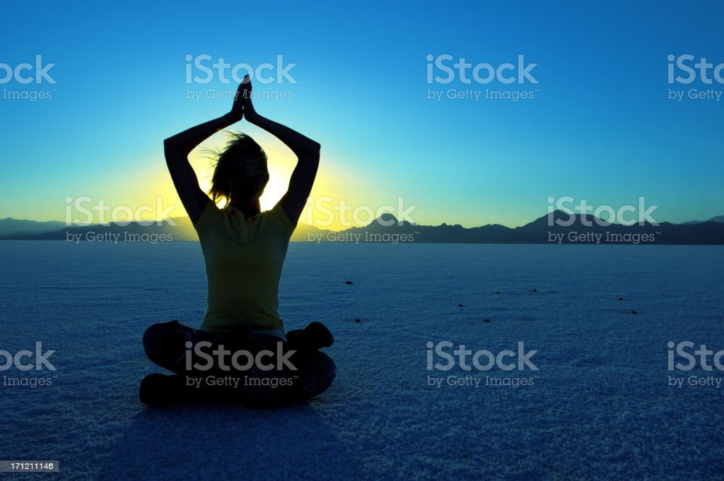 Moon Meditation Woman practicing yoga as the sun sets. Adult Stock Photo