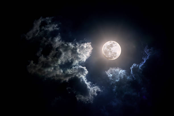 moon on cloudy day - atmospheric mood stock pictures, royalty-free photos & images