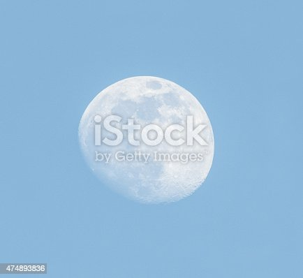 Moon over blue sky