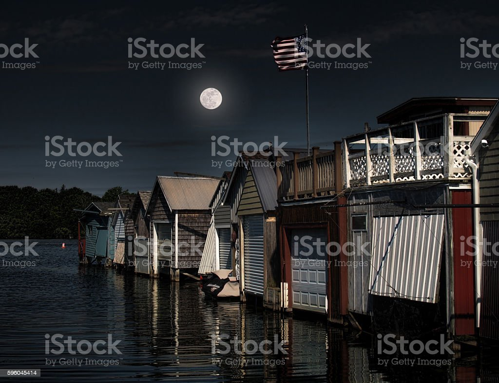 moon over boathouses royalty-free stock photo