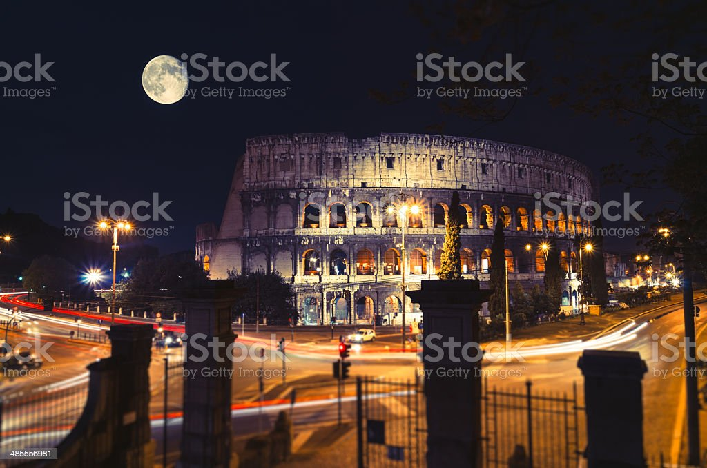 Moon over Coliseum in Rome, Italy stock photo