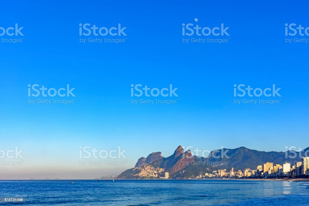 Moon over Ipanema beach stock photo