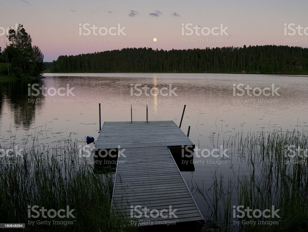 Moon over lake in Finland Scandinavia royalty-free stock photo